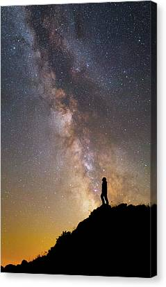 A Man On A Mountain Under The Milky Way Canvas Print by Yuri Zvezdny