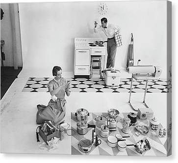 A Married Couple With Kitchen Appliances Canvas Print by Herbert Matter