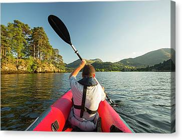 A Middle Aged Man Paddling Canvas Print by Ashley Cooper