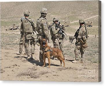A Military Working Dog Accompanies U.s Canvas Print by Stocktrek Images