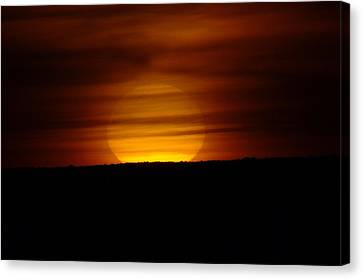 A Misted Sunset Canvas Print by Jeff Swan