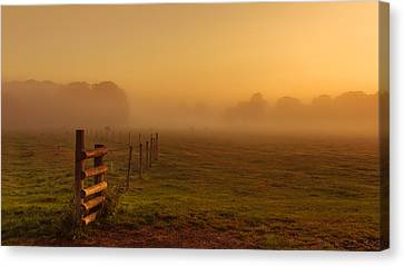 A Misty Sunrise Canvas Print by Chris Fletcher
