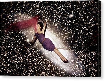 One-shoulder Dress Canvas Print - A Model Against A Galaxy Backdrop by John Rawlings