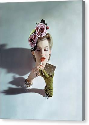 A Model Applying Lipstick Canvas Print by John Rawlings