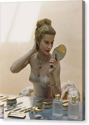 Hairstyle Canvas Print - A Model At A Dressing Table by John Rawlings