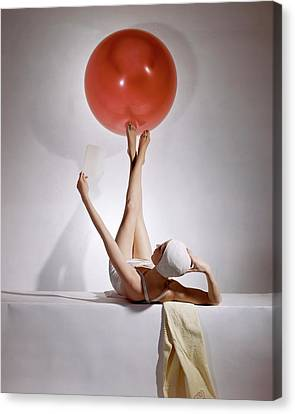 Woman Head Canvas Print - A Model Balancing A Red Ball On Her Feet by Horst P Horst
