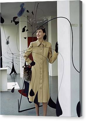 A Model Behind Calder Mobiles At The Museum Canvas Print by John Rawlings