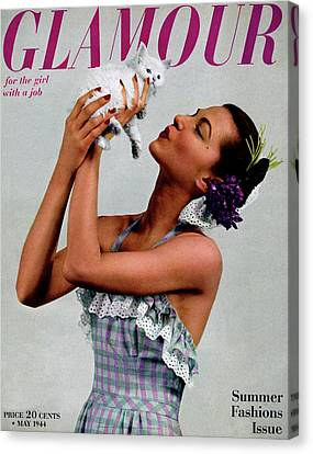 A Model Holding A Kitten Canvas Print by Gjon Mili