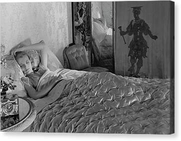 A Model In A Bed With Designer Bedding Canvas Print by Horst P. Horst