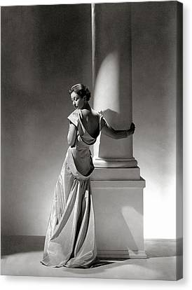A Model In A Gown By Vionnet And Jewelry Canvas Print by George Hoyningen-Huene