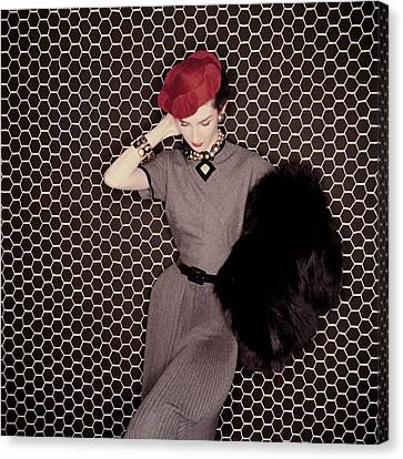 A Model In A Grey Dress And Red Hat Canvas Print