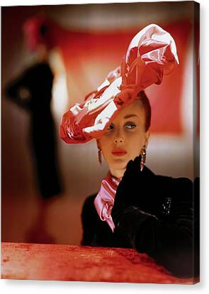 Pink Lipstick Canvas Print - A Model In A Suzanne Et Roger Hat by John Rawlings