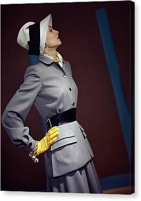 Gold Earrings Canvas Print - A Model In A Vogue Couturier Suit by Horst P. Horst