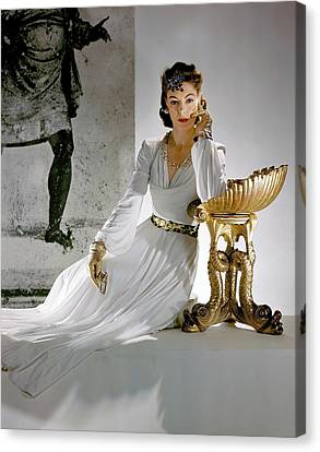 Gold Necklace Canvas Print - A Model Leaning On A Gold Pedestal by Horst P. Horst