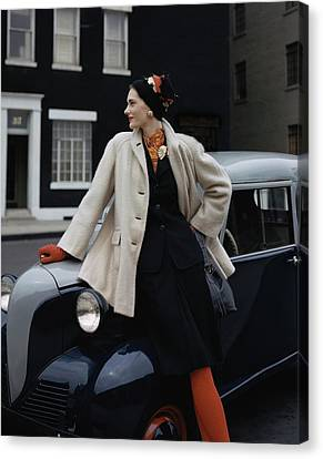 A Model Leaning On A Vintage Car Canvas Print by John Rawlings