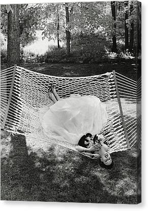 A Model Lying On A Hammock Canvas Print by Gene Moore