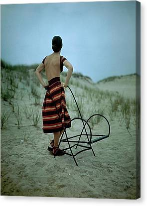 A Model On A Beach Canvas Print by Serge Balkin