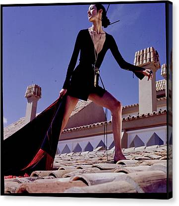 A Model On A Rooftop In A Dress By Paraphernalia Canvas Print by Henry Clarke