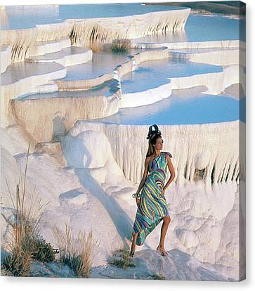 A Model On The Cliffs Of Pamukkale Canvas Print by Henry Clarke