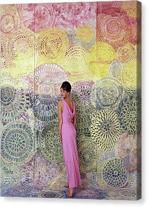 A Model Posing By A Colorful Mural Canvas Print