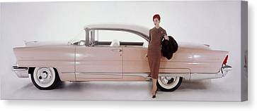 A Model Posing In Front Of A Vintage Car Canvas Print by Karen Radkai