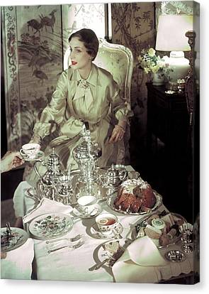 A Model Sitting In A Lavish Dining Room Canvas Print