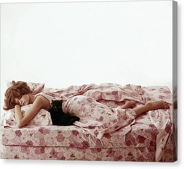 A Model Sleeping On Floral Bed Linens Canvas Print by Karen Radkai