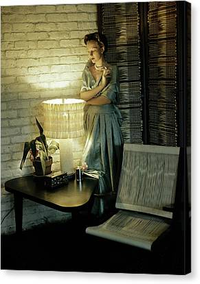 A Model Smoking By Furniture Canvas Print by Horst P. Horst