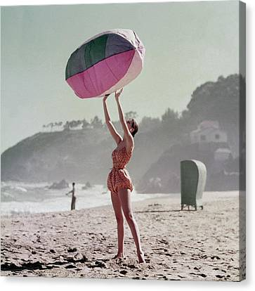 A Model Wearing A Bathing Suit Holding Up An Canvas Print by Richard Rutledge