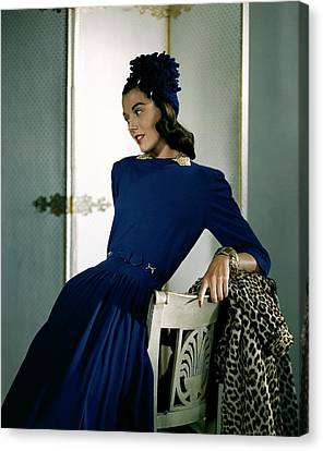 Gold Bracelet Canvas Print - A Model Wearing A Cap And Dress by Horst P. Horst