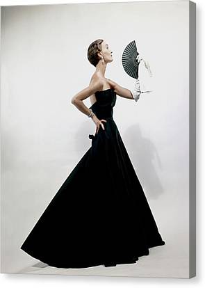 Profile Canvas Print - A Model Wearing A Christian Dior Dress by Erwin Blumenfeld