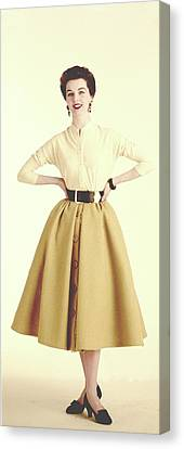 A Model Wearing A Cream Sweater And Camel Skirt Canvas Print