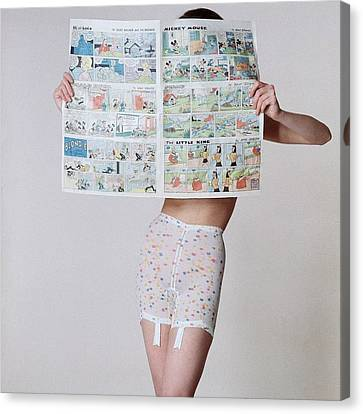 A Model Wearing A Girdle With A Comic Canvas Print by Louis Faurer