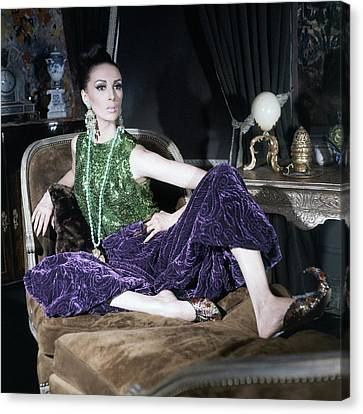 A Model Wearing A Glittery Top And Velvet Pants Canvas Print