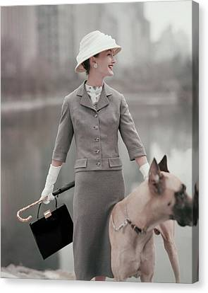 Glove Canvas Print - A Model Wearing A Gray Suit With A Dog by Karen Radkai
