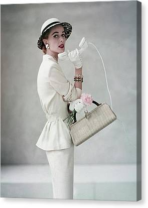 Cloche Hat Canvas Print - A Model Wearing A Handmacher Suit by Francesco Scavullo