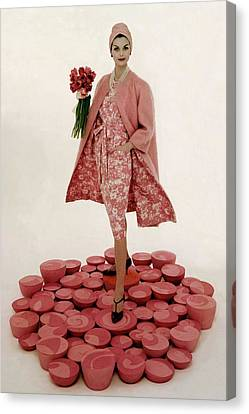 Necklace Canvas Print - A Model Wearing A Matching Pink Outfit Holding by William Bell