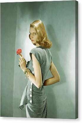 A Model Wearing A Matching Shirt And Skirt Canvas Print by Horst P. Horst