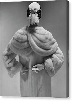 Ostrich Feathers Canvas Print - A Model Wearing A Mink Coat by Erwin Blumenfeld