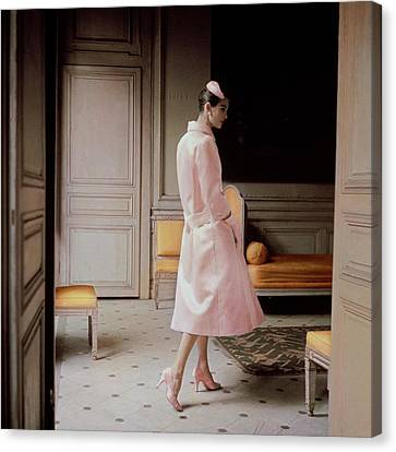 A Model Wearing A Pink Coat Canvas Print by Karen Radkai