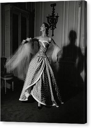 A Model Wearing A Polka Dot Dress Canvas Print by John Rawlings