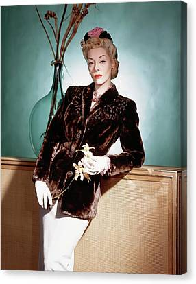 A Model Wearing A Sealskin Jacket Canvas Print by Horst P. Horst
