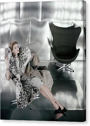 A Model Wearing A Snow Leopard Coat Canvas Print by Henry Clarke
