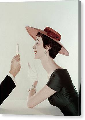 A Model Wearing A Sun Hat And Dress Canvas Print by John Rawlings
