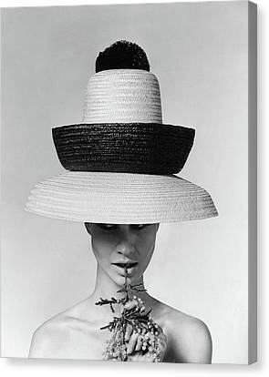 A Model Wearing A Sun Hat Canvas Print by Karen Radkai