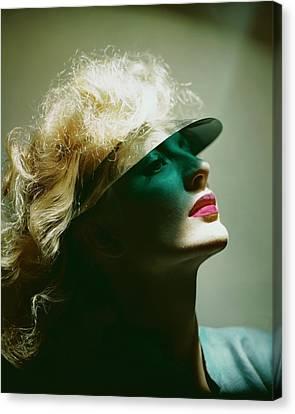 Pink Lipstick Canvas Print - A Model Wearing A Sun Shade by Erwin Blumenfeld