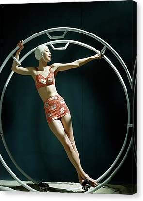 A Model Wearing A Swimsuit In An Exercise Ring Canvas Print by John Rawlings