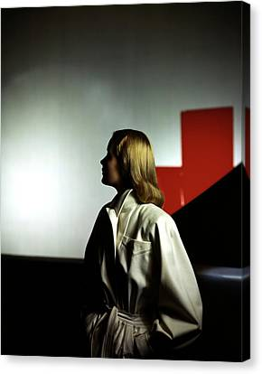 A Model Wearing A White Coat Canvas Print by Horst P. Horst