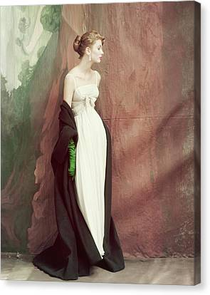 A Model Wearing A White Dress Canvas Print by John Rawlings
