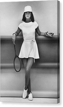 A Model Wearing A Wrap Dress And Cap Canvas Print